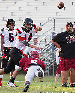 Quarterback Kaleb Morrison (14) fires a pass to Douglas Johnson during the early part of the Coldspring vs. Jasper scrimmage. Photo by Charles Ballard