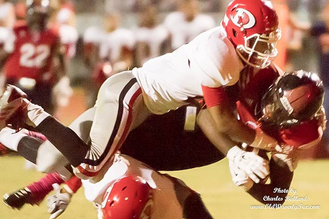 Ed Hayes (20) crashes the tough Diboll defensive line for another first and ten. (Photo by Charles Ballard}