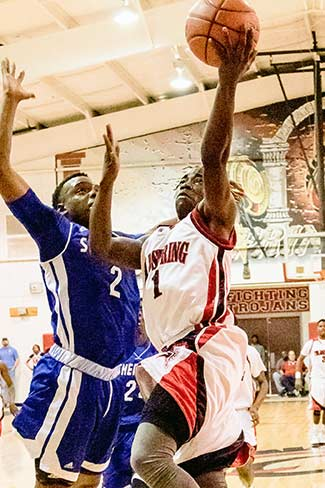Terrance Griffin (1) takes a layup against the strong Shepherd defense, during the Coldspring VS Shepherd District game. Photo by Charles Ballard